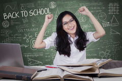 Happy student celebrate back to school in class Stock Photos