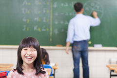 Happy student in class with teacher Stock Photo