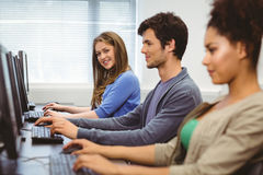 Happy student in computer class smiling at camera Stock Images