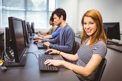 Happy student in computer class smiling at camera Royalty Free Stock Photos