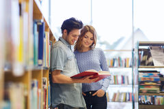 Happy student couple with books in library Royalty Free Stock Photo