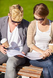 Happy student couple with notebook and coffee Royalty Free Stock Photo