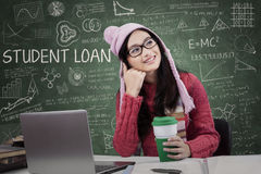 Happy student dreaming in the class Stock Photos
