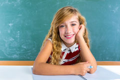 Happy student expression schoolgirl in classroom Stock Images