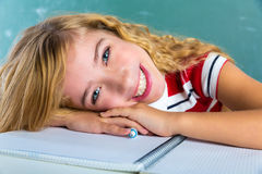 Happy student expression schoolgirl in classroom Stock Photography