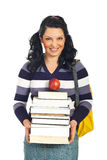 Happy student female with pile of books. Happy student woman holding pile of books and an apple and smiling isolated on white background Stock Images