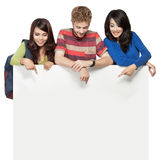 Happy student friend holding white blank board Stock Photography