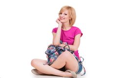 Happy student girl with backpack sitting and Stock Photo
