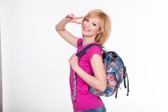 Happy student girl with backpack smiling and Stock Photo