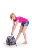 Happy student girl with backpack standing and Stock Photo
