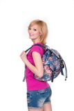 Happy student girl with backpack standing and Royalty Free Stock Images