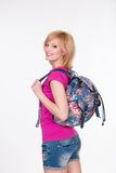 Happy student girl with backpack standing and Stock Image