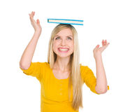 Happy student girl balancing book on head Royalty Free Stock Photos