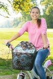Happy student girl with bicycle Royalty Free Stock Photography
