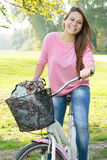Happy student girl with bicycle Stock Photography