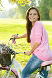 Happy student girl with bicycle Stock Image