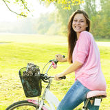 Happy student girl with bicycle Stock Photo