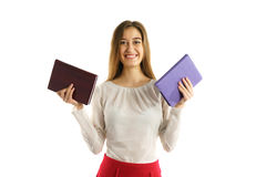 Happy student girl with book in hands Stock Photo