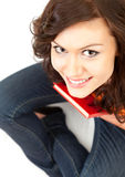 Happy student girl with book looking at camera Royalty Free Stock Photos