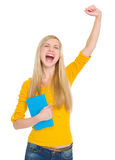 Happy student girl with book rejoicing success. Isolated on white stock photo