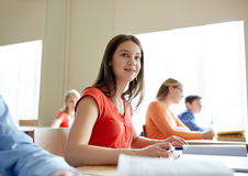 Happy student girl with book writing school test Royalty Free Stock Images