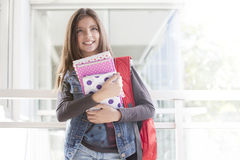 Happy student girl. With books and backpack, back to school Royalty Free Stock Photo