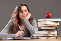 Happy student girl doing homework with books Royalty Free Stock Photos