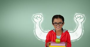 Happy student girl with fists graphic standing against green background Royalty Free Stock Images