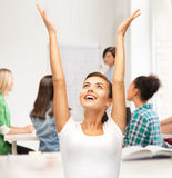 Happy student girl with hands up royalty free stock photos