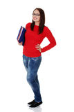 Happy student girl is holding folders and smiling. Royalty Free Stock Image