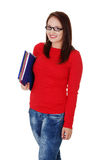 Happy student girl is holding folders and smiling. Royalty Free Stock Photography