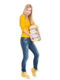 Happy student girl holding stack of books Royalty Free Stock Photography