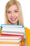 Happy student girl holding stack of books Royalty Free Stock Images
