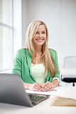 Happy student girl with laptop at school Stock Photography