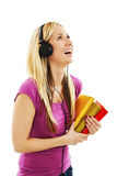 Happy student girl listening to the music Royalty Free Stock Image