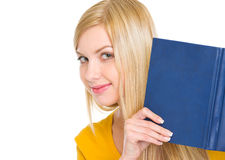 Happy student girl looking out from book Stock Image