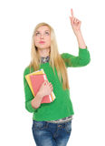 Happy student girl pointing up on copy space Royalty Free Stock Images