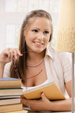 Happy student girl reading book Stock Photo