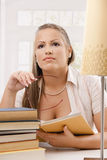 Happy student girl reading book Stock Photo