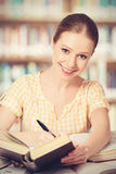 Happy student girl reading books Stock Photo