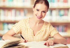 Happy student girl reading books Royalty Free Stock Photos