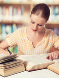 Happy student girl reading books Royalty Free Stock Image