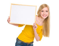 Happy student girl showing blank board Royalty Free Stock Photo