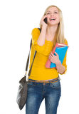 Happy student girl speaking mobile. Isolated on white Royalty Free Stock Images