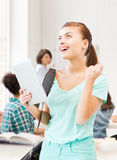 Happy student girl with tablet pc Royalty Free Stock Image