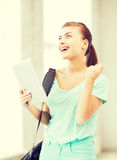 Happy student girl with tablet pc Stock Images