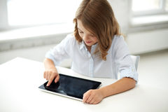 Happy student girl with tablet pc at school Royalty Free Stock Images