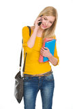 Happy student girl talking cell phone Royalty Free Stock Photos