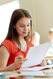 Happy student girl with test paper at school Stock Photos