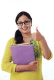 Happy student girl with thumb up against white Royalty Free Stock Photos